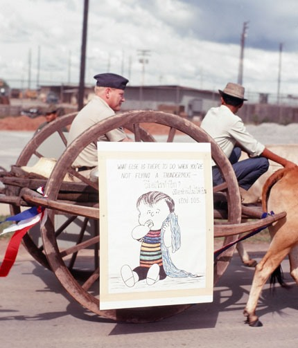 Ox Cart with Officer and Cartoon Sign